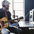 musician man guitar recording