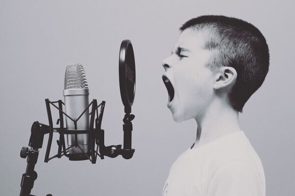 musical talents child singing microphone