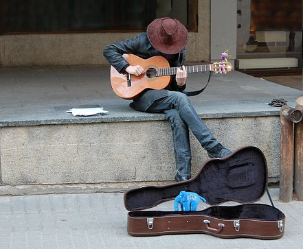 busker make music money